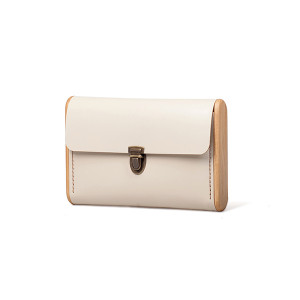 SINGLE REEL beige clutch